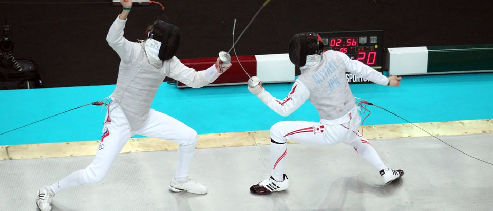 Russia's Artem Sedov (L) competes with J