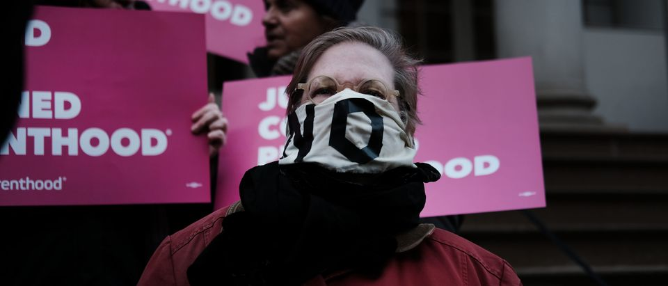 """NEW YORK, NEW YORK - FEBRUARY 25: Pro-choice activists, politicians and others associated with Planned Parenthood gather for a news conference and demonstration at City Hall against the Trump administrations title X rule change on February 25, 2019 in New York City. The proposed final rule for the Title X Family Planning Program, called the """"Gag Rule,"""" would force a medical provider receiving federal assistance to refuse to promote, refer for, perform or support abortion as a method of family planning. (Photo by Spencer Platt/Getty Images)"""