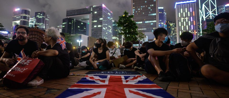 A British Union Jack flag is displayed as protesters gather along a fenced-off Victoria Harbour pier in Hong Kong, late on June 28, 2019. (ANTHONY WALLACE/AFP/Getty Images)