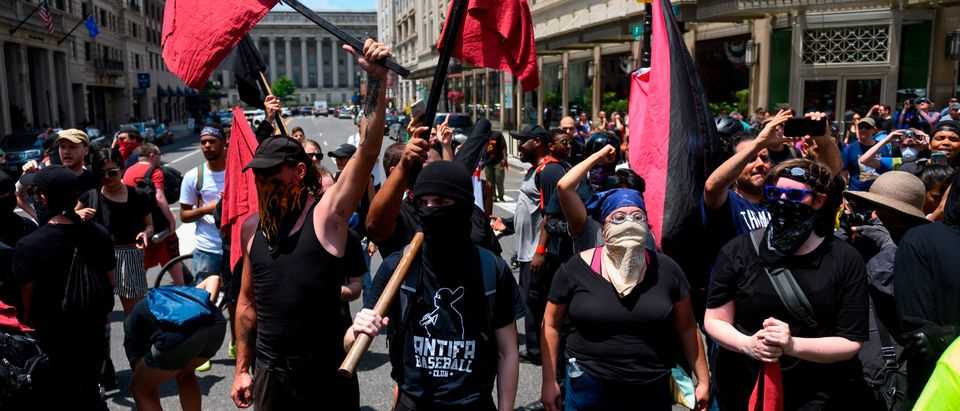 "Members of an anti-fascist or Antifa group march as the Alt-Right movement gathers for a ""Demand Free Speech"" rally in Washington, DC, on July 6, 2019. (ANDREW CABALLERO-REYNOLDS/AFP/Getty Images)"