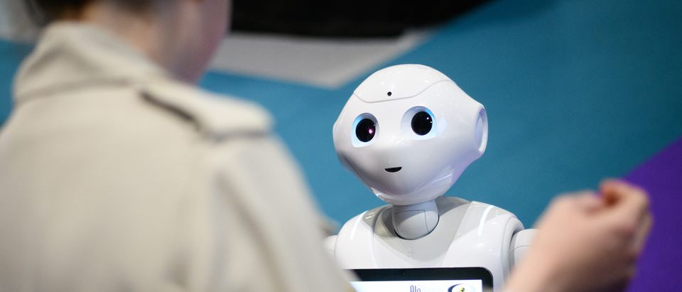 A robot created by the Cyberselves project wanders through the exhibition space during the TechXLR8 event at ExCel on June 12, 2019 in London, England. TechXLR8 is London Tech Week's flagship event, allowing businesses to promote and showcase their latest technology developments. (Photo by Leon Neal/Getty Images)