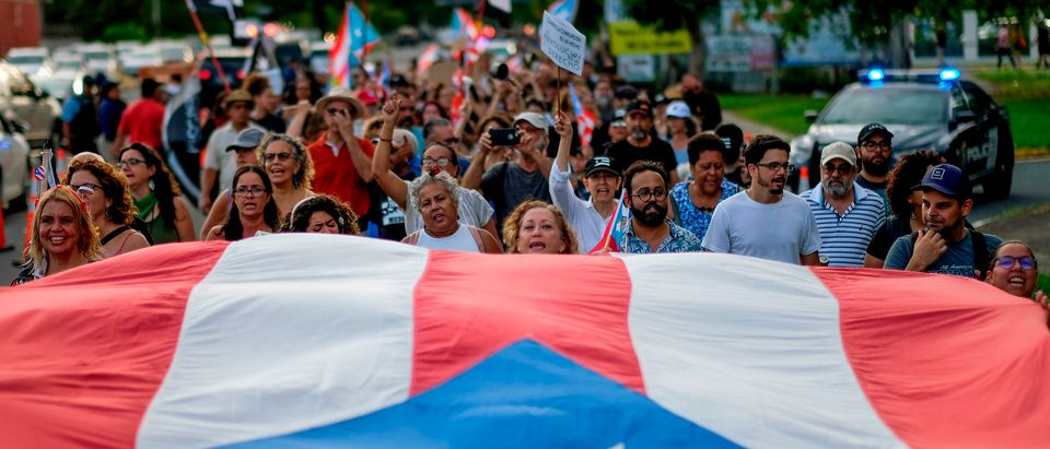 People march in protest in San Juan on July 29, 2019, against the next in line for Puerto Rico's governor, Wanda Vazquez, Puerto Rico's current Secretary of Justice. (RICARDO ARDUENGO/AFP/Getty Images)