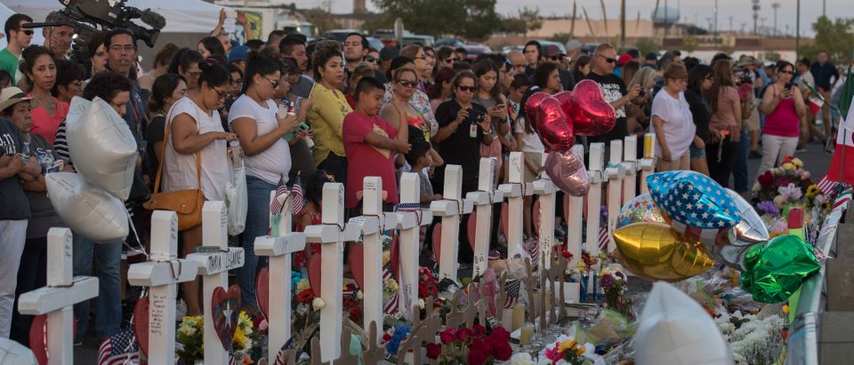 People pay their respects at a makeshift memorial for victims of Walmart shooting that left a total of 22 people dead at the Cielo Vista Mall WalMart in El Paso, Texas, on Aug. 5, 2019. (MARK RALSTON/AFP/Getty Images)