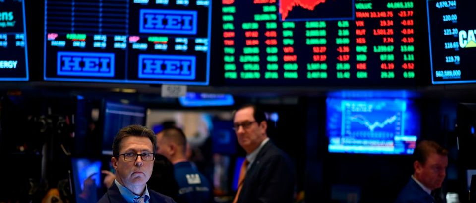US-ECONOMYTraders work after the closing bell at the New York Stock Exchange (Photo credit should read JOHANNESEISELE/AFP/Getty Images)-STOCKS-MARKETS-CLOSE