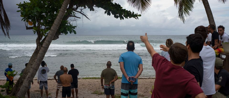 People gather at the coast hours before the Tropical Storm Dorian enters in Patillas, Puerto Rico on, August 28, 2019. (ERIC ROJAS/AFP/Getty Images)