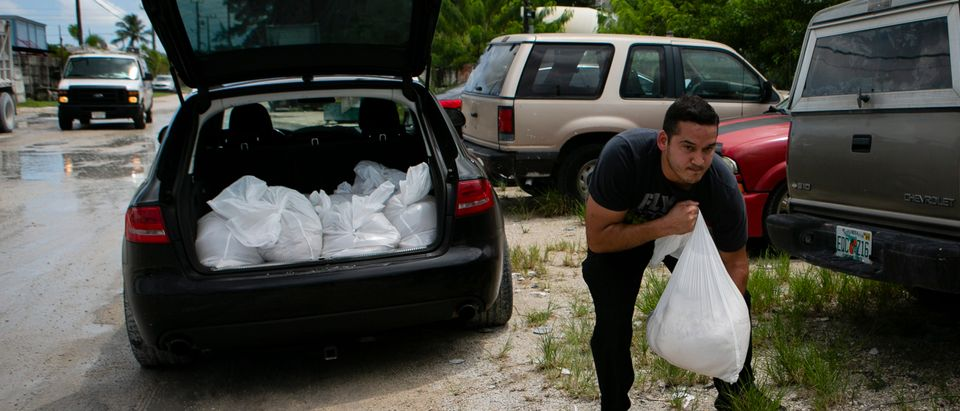 A men carries sandbags into his car at Rudys Ready Mix who donated sandbags to Miami-Dade residents in West Miami on August 30, 2019. (EVA MARIE UZCATEGUI/AFP/Getty Images)