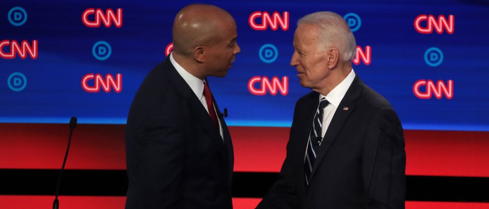 DETROIT, MICHIGAN - JULY 31: Democratic presidential candidate former Vice President Joe Biden (R) and Sen. Cory Booker (D-NJ) shake hands after the Democratic Presidential Debate at the Fox Theatre July 31, 2019 in Detroit, Michigan. 20 Democratic presidential candidates were split into two groups of 10 to take part in the debate sponsored by CNN held over two nights at Detroit's Fox Theatre. (Photo by Scott Olson/Getty Images)