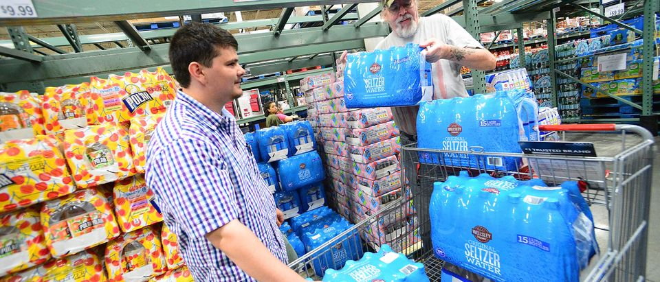 Residents Al-Muthanna Al-Ani (L) and Lloyd Strickland buy supplies in preparation for Hurricane Dorian at BJ's store on August 29, 2019 in Orlando, Florida. (Gerardo Mora/Getty Images)