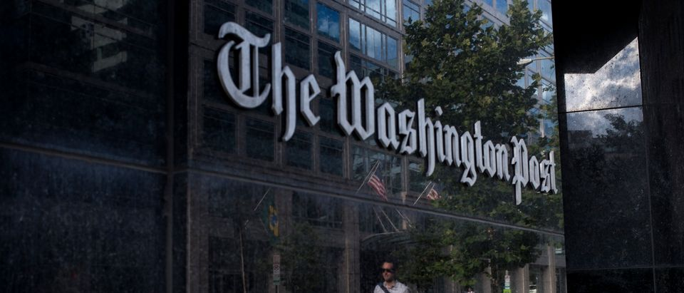 A man walks past The Washington Post on August 5, 2013 in Washington, DC after it was announced that Amazon.com founder and CEO Jeff Bezos had agreed to purchase the Post for USD 250 million. (BRENDAN SMIALOWSKI/AFP/Getty Images)