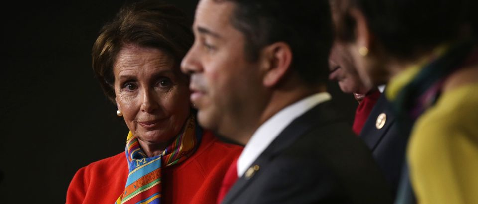 U.S. Rep. Ben Ray Luján (D-NM) (R) speaks as House Minority Leader Rep. Nancy Pelosi (D-CA) (L) listens during a news conference to announce new members of the House Democratic leadership team November 17, 2014. (Photo by Alex Wong/Getty Images)