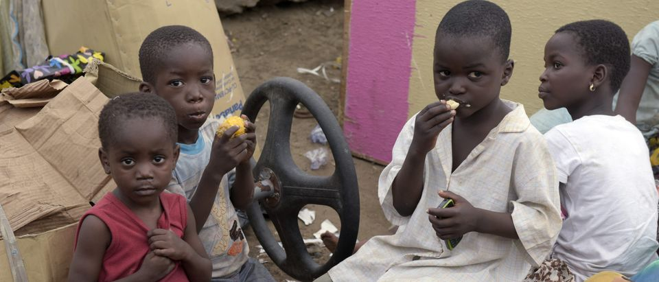 Children eat their meals along the roadside away from their demolished home following a court ruling which forcefully evicted residents of Badiya community at Ijora distict of Lagos, on Sept. 18, 2015. (PIUS UTOMI EKPEI/AFP/Getty Images)