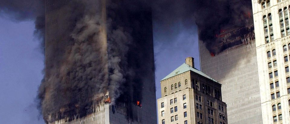 The twin towers of World Trade Center burn after two planes crashed into each building 11 September, 2001, in New York. (STAN HONDA/AFP/Getty Images)