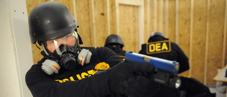 US Drug Enforcement Administration (DEA) Agents simulate a raid in their Tactical Training Facility, part of the new National Clandestine Laboratory Training and Research Facility December 5, 2008 at the DEA Training Academy in Quantico, Virginia. Since 1987, DEA has trained over 19,000 officials to operate safely in clandestine laboratories which are commonly referred to as meth labs. According to the National Clandestine Laboratory Database, since 1999 there have been 106,681 reported incidents in the United States involving contaminated meth laboratory sites. (TIM SLOAN/AFP/Getty Images)