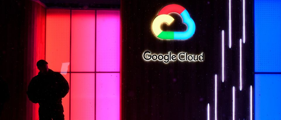 A man guards the entrance of the Google Cloud booth of the World Economic Forum (WEF) 2018 annual meeting on January 21, 2018 in Davos, eastern Switzerland. (Photo credit should read FABRICE COFFRINI/AFP/Getty Images)
