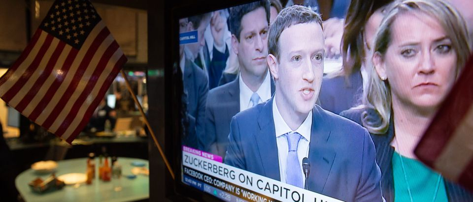 A broadcast of Facebook CEO Mark Zuckerberg testifying on Capital Hill is televised on the floor at the closing bell of the Dow Industrial Average at the New York Stock Exchange on April 10, 2018 in New York. (Photo: BRYAN R. SMITH/AFP/Getty Images)