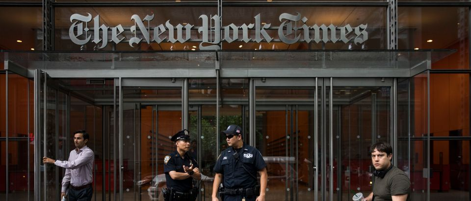 Members of the New York City Police Department stand outside the headquarters of The New York Times, June 28, 2018 in New York City. (Drew Angerer/Getty Images)