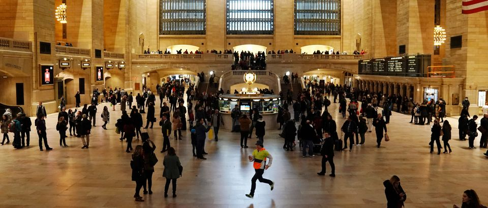 A man runs though Grand Central Terminal in New York