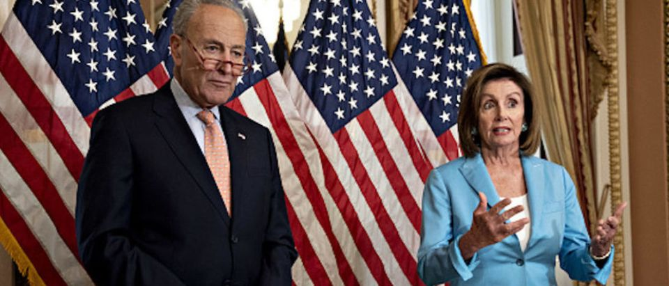 House Speaker Nancy Pelosi, a Democrat from California, right, speaks before signing H.R. 3877, the Bipartisan Budget Act of 2019, with Senate Minority Leader Chuck Schumer, a Democrat from New York, at the U.S. Capitol in Washington, D.C.
