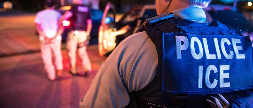 ICE officers carry out a raid as part of Operation Cross Check in Sherman Texas