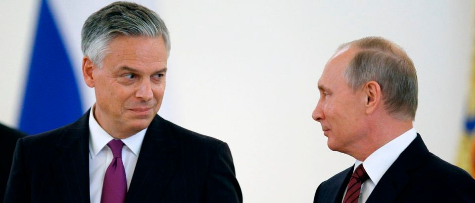 Russian President Vladimir Putin (R) looks at U.S. Ambassador to Russia Jon Huntsman during a ceremony of receiving diplomatic credentials from foreign ambassadors at the Kremlin in Moscow on Oct. 3, 2017. (Photo: PAVEL GOLOVKIN/AFP/Getty Images)