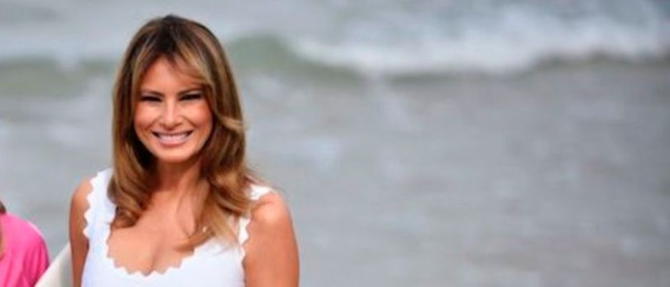 U.S. First Lady Melania Trump (C) looks on during a meeting with surfers at the Cote des Basques beach, in Biarritz, south-western France, on August 26, 2019, on the third and final day of the annual G7 summit. Photo credit: JULIEN DE ROSA/AFP/Getty Images)
