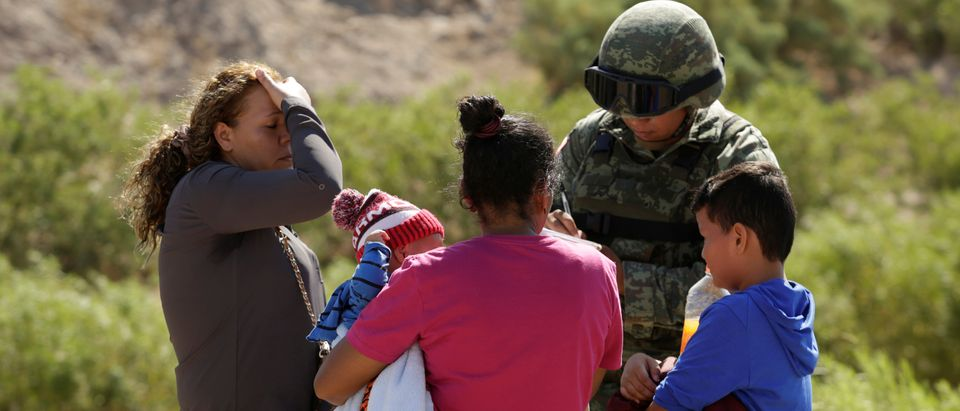 Honduran migrants are stopped by Mexican National Guard in Anapra, outskirts of Ciudad Juarez