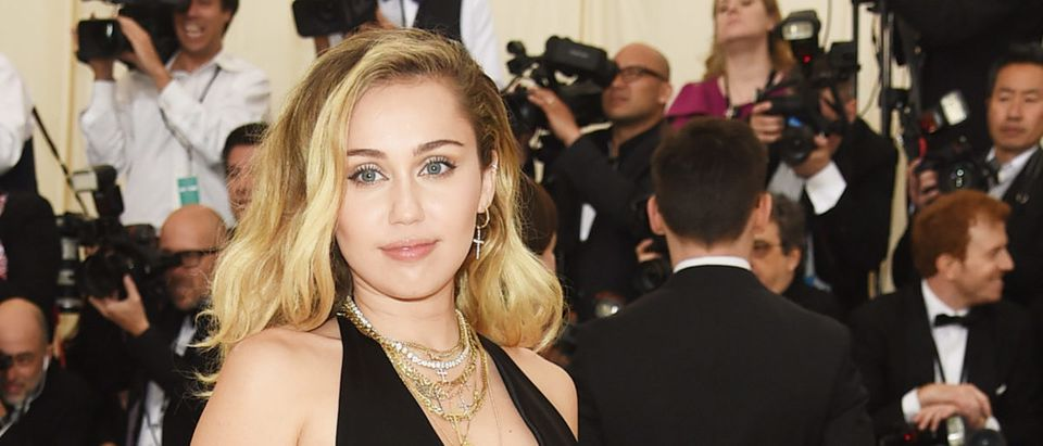 Miley Cyrus attends the Heavenly Bodies: Fashion & The Catholic Imagination Costume Institute Gala at The Metropolitan Museum of Art on May 7, 2018 in New York City. (Photo by Jamie McCarthy/Getty Images)