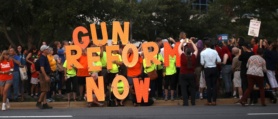 FAIRFAX, VIRGINIA - AUGUST 05: Advocates of gun reform legislation hold a candle light vigil for victims of recent mass shootings outside the headquarters of the National Rifle Association August 5, 2019 in Fairfax, Virginia. Thirty-one people have died following the two mass shootings over the weekend in El Paso, Texas and Dayton, Ohio. (Photo by Win McNamee/Getty Images)