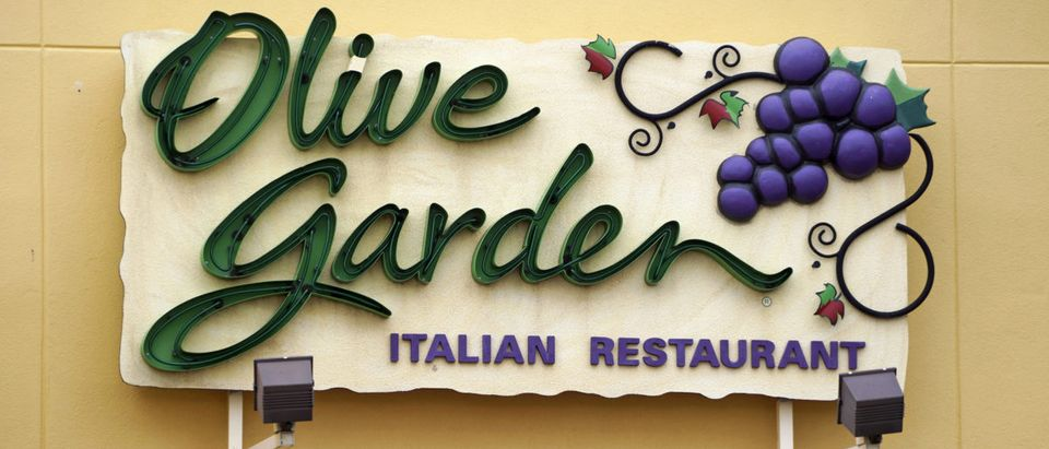 The sign outside the Olive Garden restaurant is seen in Westminster, Colorado March 19, 2015. REUTERS/Rick Wilking