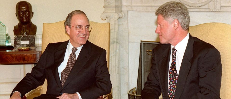 President Bill Clinton meets with George Mitchell in the Oval Office on April 13, 1998. (Paul J. Richards/AFP/Getty Images)