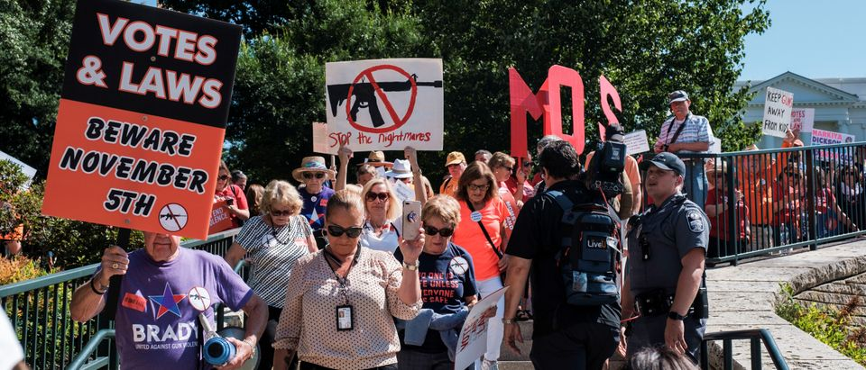 Members of Moms Demand Action and other gun control advocates hold a gun control rally in Richmond