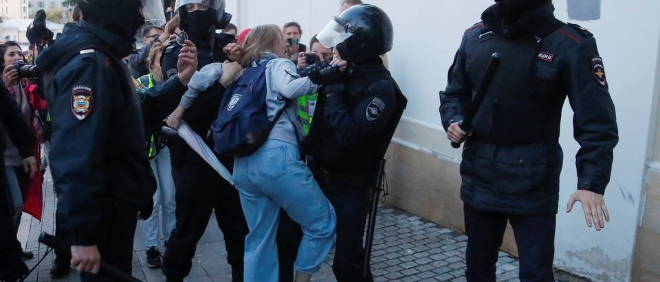 Law enforcement officers detain Muscovite Daria Sosnovskaya after a rally to demand authorities allow opposition candidates to run in a local election in Moscow