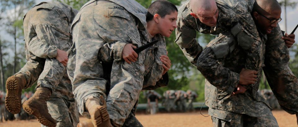Handout photo shows Then U.S. Army First Lieutenan Kirsten Griest and fellow soldiers participating in combatives training during the Ranger Course on Fort Benning, Georgia