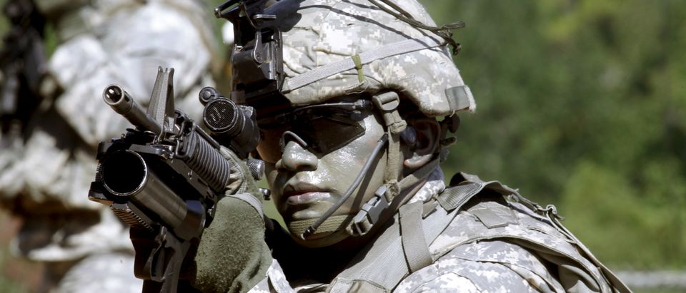 U.S. Army Ranger shows skills during a demonstration at Ranger school graduation at Fort Benning in Columbus