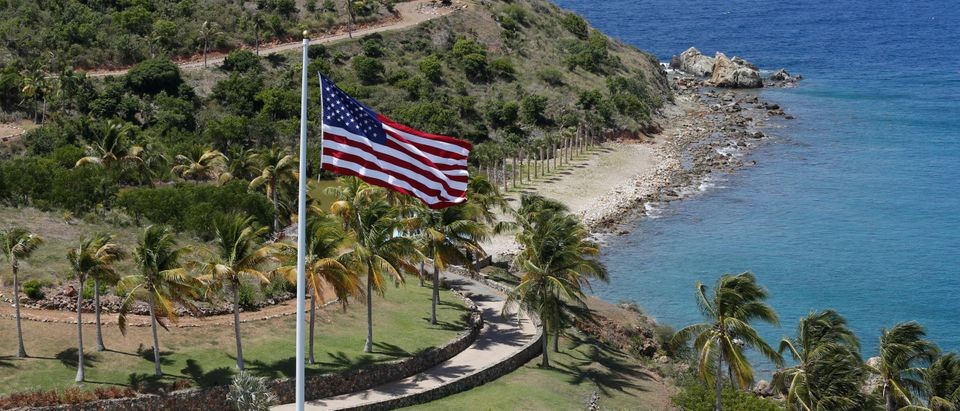 An American flag flies next to a swimming pool at Little St. James Island, one of the properties of financier Jeffrey Epstein, in an aerial view, near Charlotte Amalie, St. Thomas. (REUTERS/Marco Bello)