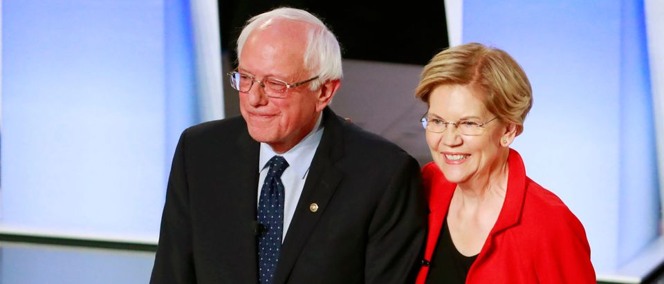 Warren and Sanders on a debate stage. (Reuters/Lucas Jackson)