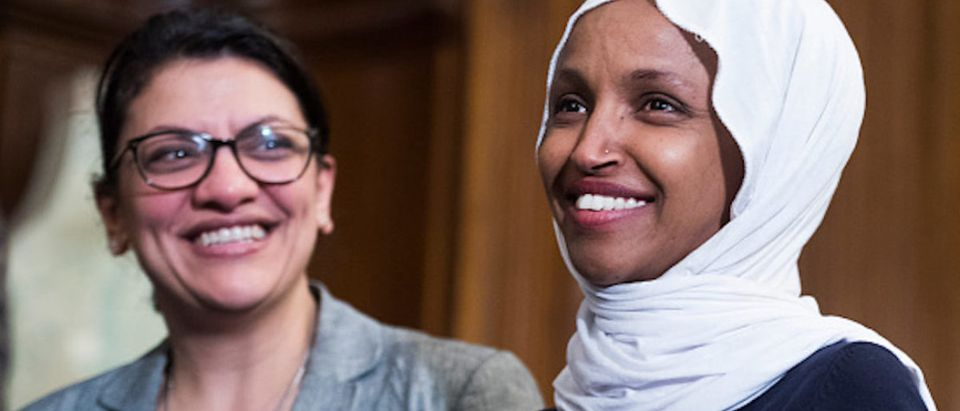 """UNITED STATES - MARCH 13: Reps. Ilhan Omar, D-Minn., right, and Rashida Tlaib, D-Mich., attend a rally with Democrats in the Capitol to introduce the """"Equality Act,"""" which will amend existing civil rights legislation to bar discrimination based on gender identification and sexual orientation on Wednesday, March 13, 2019. (Photo By Tom Williams/CQ Roll Call)"""