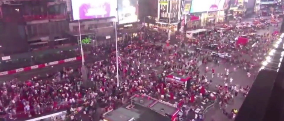 Crowds rush to evacuate Time Square after mistaking a motorcycle backfire for a gunshot. (TWITTER/Dan Snyder)
