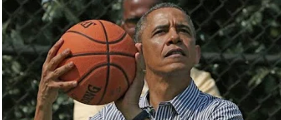 Obama shooting baskets.
