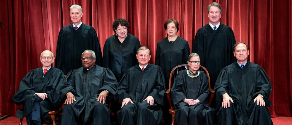 The justices of the Supreme Court are pictured on Nov. 30, 2018 standing from left: Justices Neil Gorsuch, Sonia Sotomayor, Elena Kagan and Brett Kavanaugh. Seated from left to right: Justices Stephen Breyer, Clarence Thomas, Chief Justice John Roberts, Justices Ruth Bader Ginsburg and Samuel Alito. (Mandel Ngan/AFP/Getty Images)