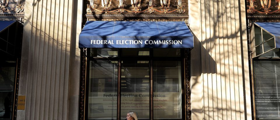 A pedestrian walks past the Federal Election Commission's headquarters Oct. 24, 2016 in Washington, D.C. (Photo by Chip Somodevilla/Getty Images)