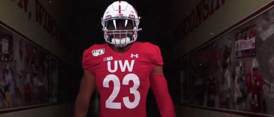 Wisconsin Football Throwback Uniforms (Credit: Screenshot/Twitter Video https://twitter.com/BadgerFootball/status/1161321518220996613)