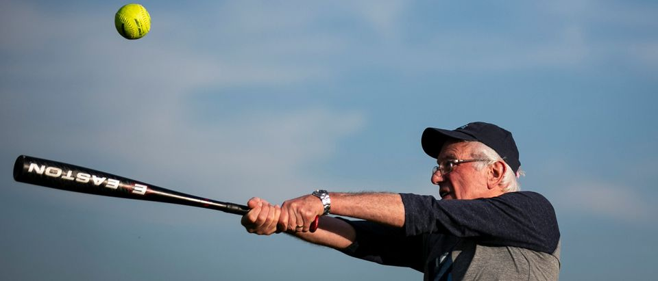 "2020 Democratic U.S. presidential candidate and U.S. Senator Bernie Sanders warms up before a baseball game between his staff, ""The Revolutionaries,"" and the Leaders Believers Achievers Foundation. U.S., August 19, 2019. REUTERS/Al Drago"