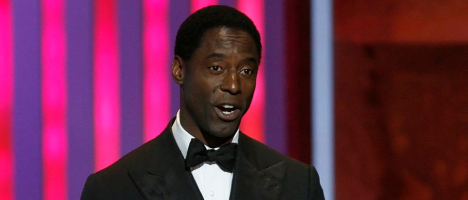 "Actor Isaiah Washington speaks as he stands onstage with his award for outstanding actor in a television drama series for his role in ""Grey's Anatomy,"" at the 38th Annual NAACP Image Awards at the Shrine auditorium in Los Angeles March 2, 2007. REUTERS/Mario Anzuoni"