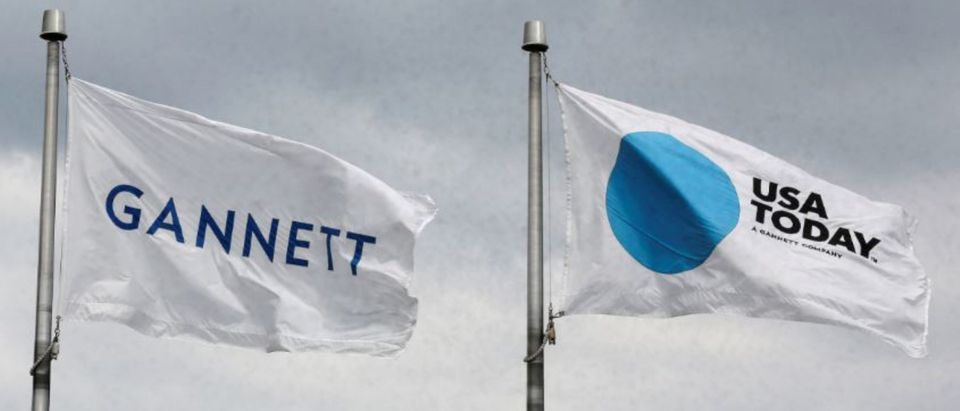 The corporate flags for the Gannett Co and its flagship newspaper, USA Today, fly outside their corporate headquarters in McLean, Virginia, July 23, 2013. REUTERS/Larry Downing
