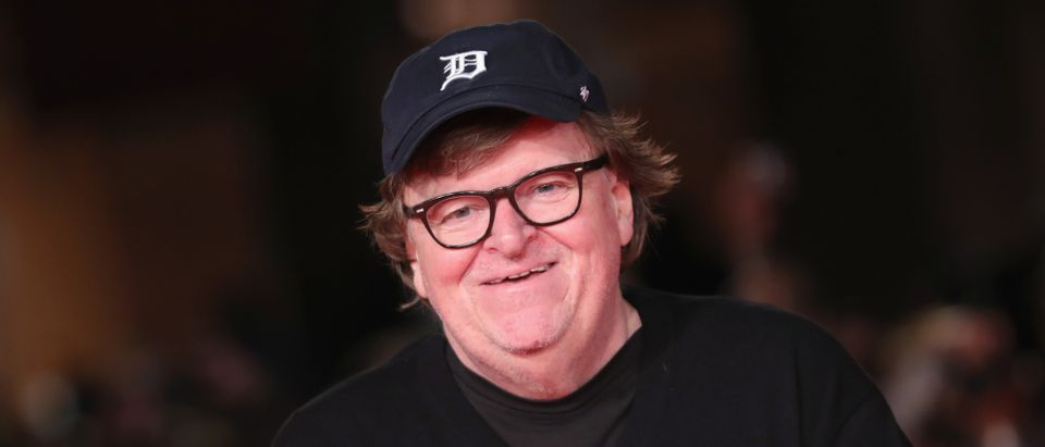"Michael Moore walks the red carpet ahead of the ""Fahreneit 11/9"" screening during the 13th Rome Film Fest at Auditorium Parco Della Musica on October 20, 2018 in Rome, Italy. (Photo by Vittorio Zunino Celotto/Getty Images)"