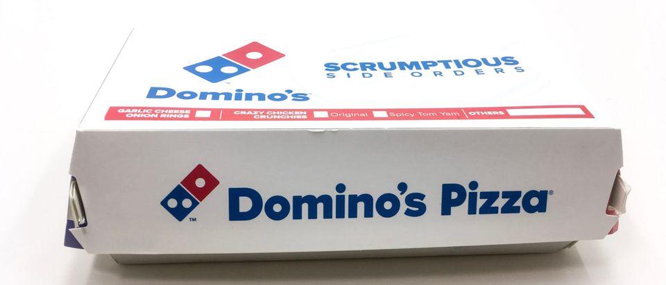 Malacca/Malaysia - March 31 2019 : Domino's Pizza Box on on white background (BELIMBINGperak/Shutterstock)