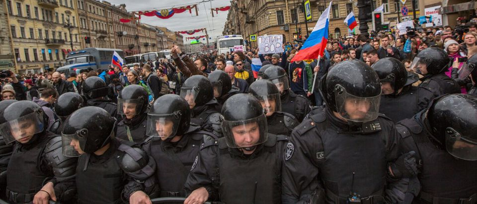 Police officers in riot gear block an Nevsky prospect during an opposition protest rally ahead of President Vladimir Putin's inauguration ceremony (shutterstock_De Visu)