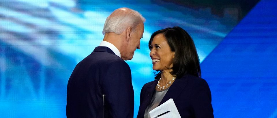 Former Vice President Biden talks with Senator Harris after the conclusion of the 2020 Democratic U.S. presidential debate in Houston, Texas, U.S.