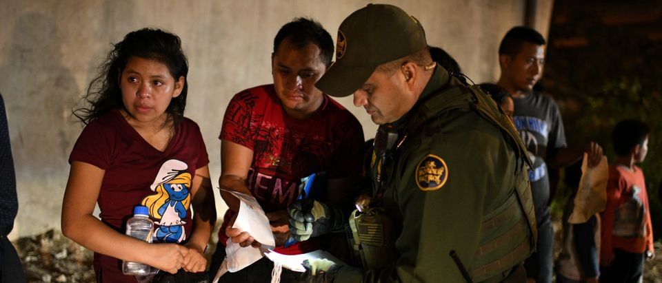 Thirteen-year-old Joseline and father Jose Luis, Guatemalan migrants, turn themselves in to U.S. Border Patrol with fellow asylum seekers after an illegal crossing of the Rio Grande in Hidalgo, Texas, U.S., Aug. 23, 2019. REUTERS/Loren Elliott